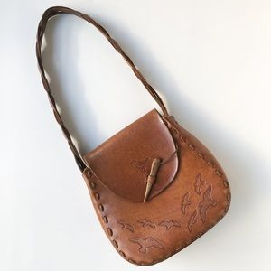 Vintage • tooled leather shoulder bag